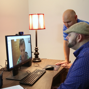 Clinician working with client through the computer